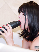 She is shoving a Gigantic Black Cock in her Twat