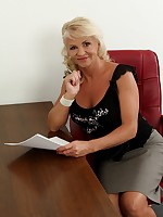 Mature office babe Iris strips naked on her desk